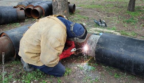 Welder Welding Two Big Pipes