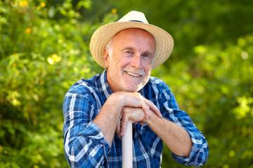 Smiling senior gardener