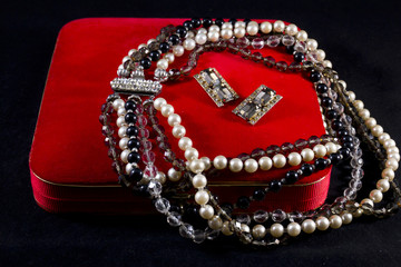 Jewelry box with a pearl necklace and earrings