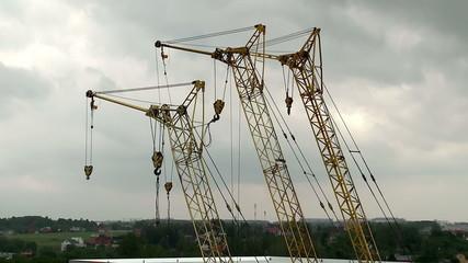 Building cranes on a construction site