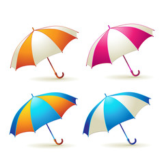 Colored umbrellas over white background