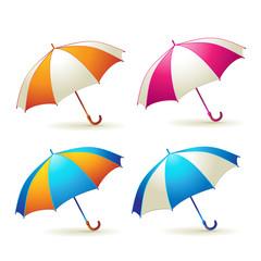 Colored umbrellas over white background