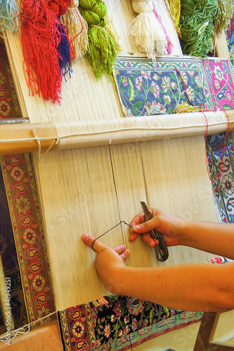 The woman behind work - weaving a carpet of silk