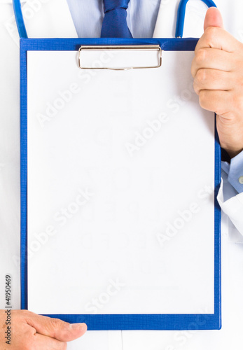 Doctor showing a white sheet of paper