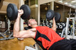 Man lifting weights in a fitness club