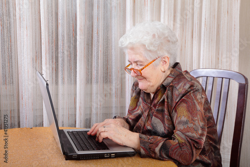 Active retirement, senior woman and laptop computer
