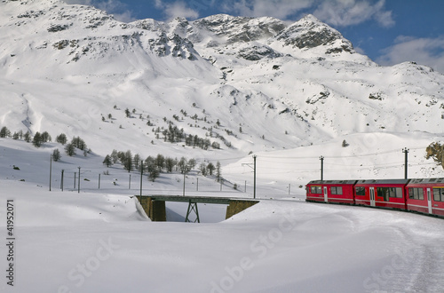 Red train and snow valley