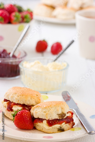 Home-baked scones strawberry jam, clotted cream strawberries.