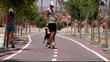 skateboarder man speed and woman running