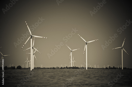 Wind turbine farm on rural terrain