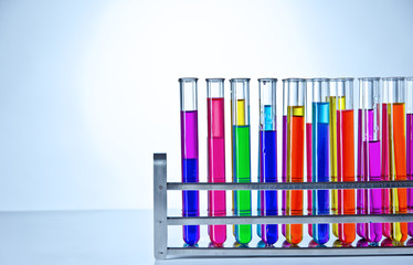 Laboratory test tubes with colored liquids inside