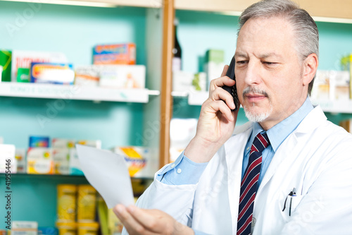Chemist taking a look at a prescription