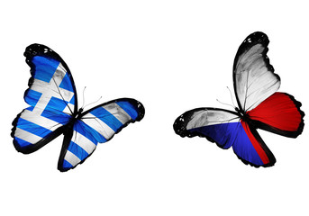 Concept - two butterflies with Greek and Czech flags flying