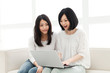 Beautiful young women using a laptop computer. Portrait of asian