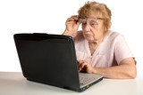 Granny with the laptop isolated on a white