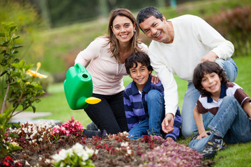 Family watering the plants