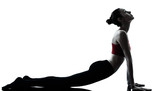 woman exercising yoga sun salutation