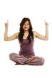 Asian woman in lotus position pointing up