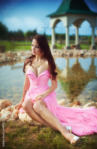 girl in a long pink dress
