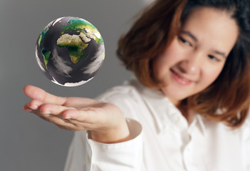 the earth globe in hand