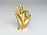 golden hand sculpture making the ok gesture