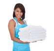Smiling maid woman with towels