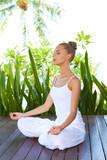 Woman in lotus position meditating