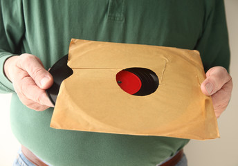 removing old vinyl record from sleeve