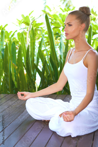Woman in deep contemplation while meditating