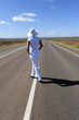 Sexy Woman standing on endless highway in outback Australia