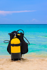 Scuba diving equipment on a beach