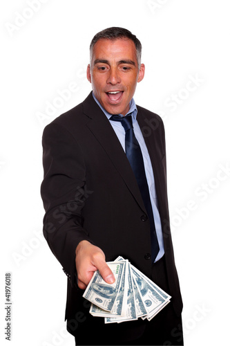 Excited executive holding and showing cash money