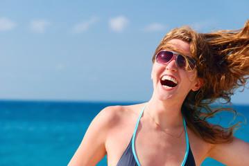 happy beautiful woman on sea