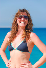 very happy beautiful woman at the sea