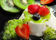 panna cotta with kiwi cream and berries