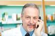 Senior pharmacist at phone