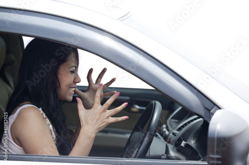 Angry female driver driving a car