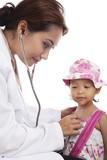 Doctor examining child with stethoscope