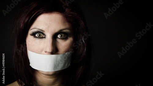 Woman with duct tape over mouth