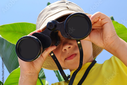 explorer boy with binoculars