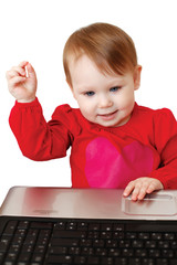 Cute baby girl holding laptop