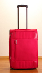 Red suitcase in the room