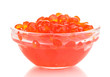 Red caviar in glass bowl isolated on white