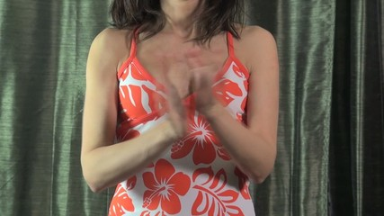 orange dress woman clapping