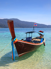 long tail boat sit on the beach, Rawi island, Thailand