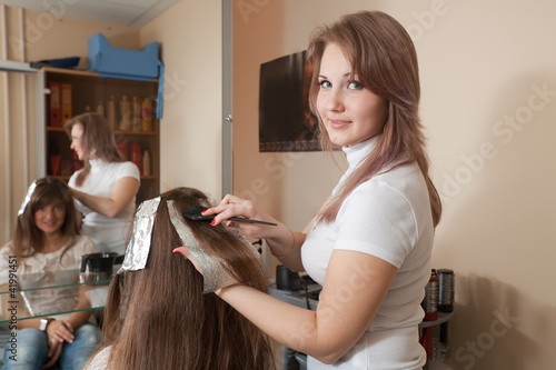Hairdresser coloring   girl hair
