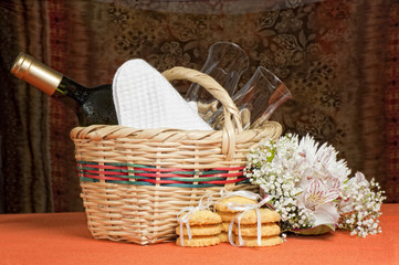 basket with bottles and glasses