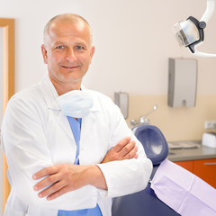 Mature dentist surgeon at office