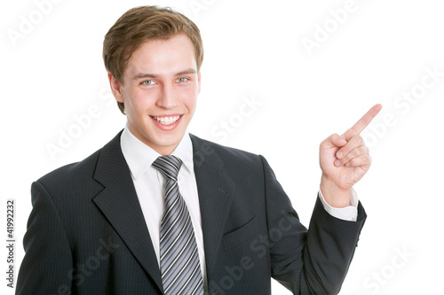 Business man pointing showing copy space