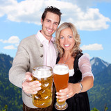 Heaven of bavaria - couple having a beer - clinking glasses